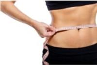 Girl measuring waist circumference.. #22853560